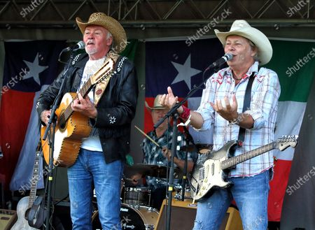 Stock Photo of Paul Young and Jamie Moses of Los Pacaminos musical group perform live on stage at Hatfield Park.