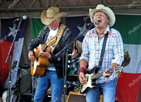 Stock Picture of Paul Young and Jamie Moses of Los Pacaminos musical group perform live on stage at Hatfield Park.