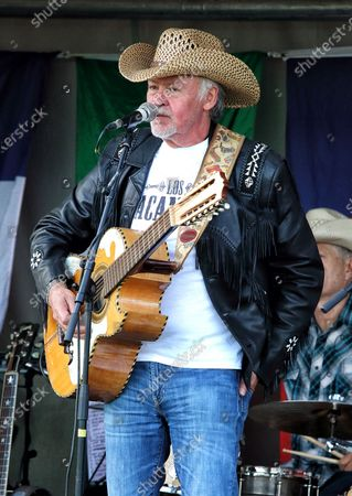 Stock Photo of Paul Young of Los Pacaminos musical group performs live on stage at Hatfield Park.