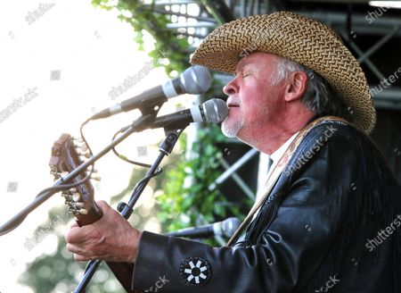 Paul Young of Los Pacaminos musical group performs live on stage at Hatfield Park.