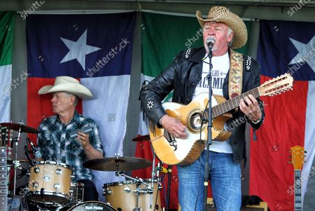 Stock Image of Paul Young of Los Pacaminos musical group performs live on stage at Hatfield Park.