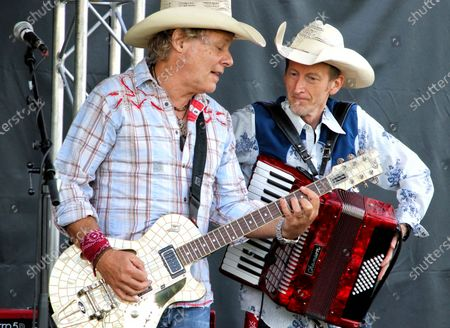 Jamie Moses and Matt Irving of Los Pacaminos musical group perform live on stage at Hatfield Park.