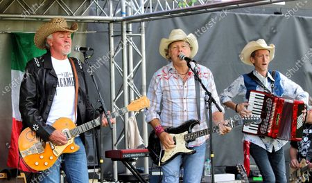 Paul Young, Jamie Moses and Matt Irving of Los Pacaminos musical group perform live on stage at Hatfield Park.