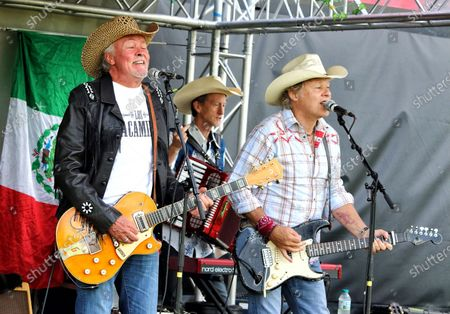 Paul Young and Jamie Moses of Los Pacaminos musical group perform live on stage at Hatfield Park.