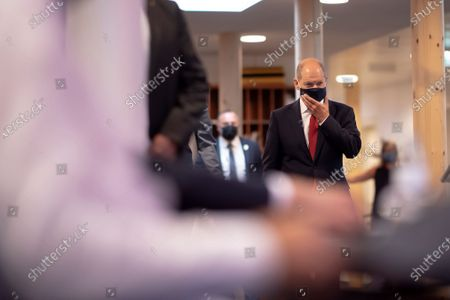 German Minister of Finance and Social Democratic Party (SPD) candidate for chancellor Olaf Scholz checks his protective face mask as he arrives for a press conference next to leader of Austrian Social Democratic Party (SPOe) Pamela Rendi-Wagner, at the office building 'Pavilion Ring' of the temporary parliament building in Vienna, Austria, 24 August 2020. Scholz is on a two-day visit in Vienna to meet the German speaking Finance Ministers on 25 August 2020.