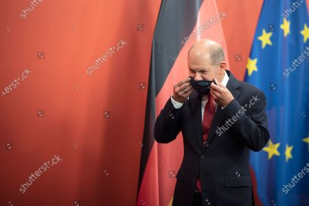 Stock Picture of German Minister of Finance and Social Democratic Party (SPD) candidate for chancellor Olaf Scholz (L) puts on his protective face mask as he leaves after a press conference next to leader of Austrian Social Democratic Party (SPOe) Pamela Rendi-Wagner, at the office building 'Pavilion Ring' of the temporary parliament building in Vienna, Austria, 24 August 2020. Scholz is on a two-day visit in Vienna to meet the German speaking Finance Ministers on 25 August 2020.