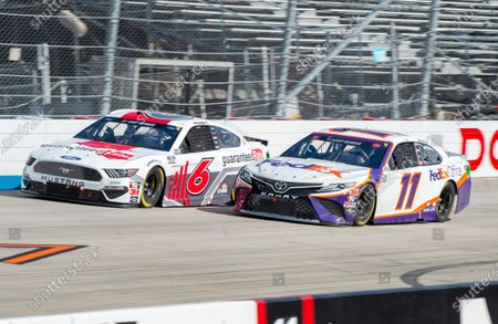 Ryan Newman (6) and Denny Hamlin (11) race side by side during a NASCAR Cup Series auto race at Dover International Speedway, in Dover, Del