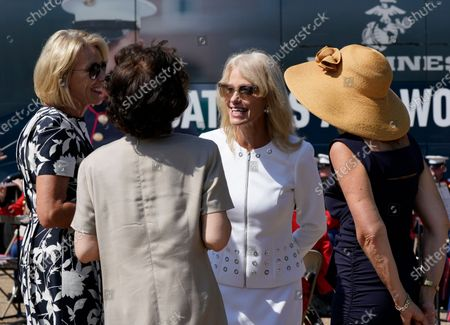 Stock Photo of Kellyanne Conway, one of President Donald Trump's most influential and longest serving advisers, speaks with Education Secretary Betsy Devos, left, and Transportation Secretary Elaine Chao, second from left, at an event with First Lady Melania Trump, in front of the White House in Washington, . Conway announced Sunday that she would be leaving the White House at the end of the month, citing a need to spend time with her four children