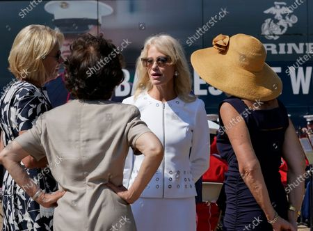 Kellyanne Conway, one of President Donald Trump's most influential and longest serving advisers, speaks with Education Secretary Betsy Devos, left, and Transportation Secretary Elaine Chao, second from left, at an event with First Lady Melania Trump, in front of the White House in Washington, . Conway announced Sunday that she would be leaving the White House at the end of the month, citing a need to spend time with her four children