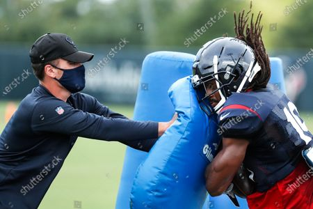 Stock Photo of Houston Texans wide receiver Isaac Whitney (19) runs into a blocking pad after making a catch during an NFL training camp football practice, in Houston