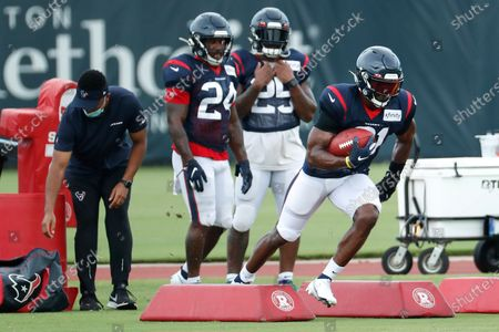 Houston Texans running back David Johnson (31) runs the ball during an NFL training camp football practice, in Houston