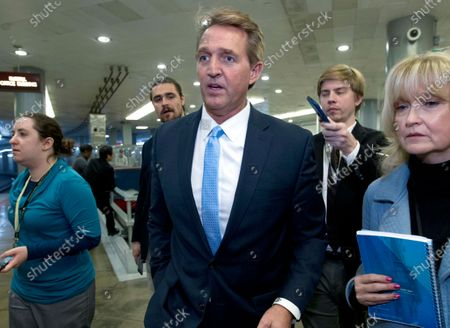 """Stock Photo of Sen. Jeff Flake, R-Ariz., a member of the Senate Foreign Relations Committee, speaks with reporters on his way to the senate chamber at the Capitol in Washington. Flake is backing Democrat Joe Biden for president. Flake, tried to make a case to conservatives to deny Donald Trump a second term on the opening day of the GOP convention. He decried a culture of name-calling, tribalism and conspiracy theories. He says: """"Character matters. Decency matters. Civility never goes out of style"""