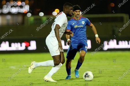 Al-Shabab's player Alfred N'Diaye (L) in action against Abha's Saleh Al Abbas (R) during the Saudi Professional League soccer match between Al-Shabab and Abha, in Riyadh, Saudi Arabia, 24 August 2020.