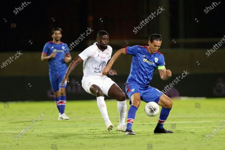Al-Shabab's player Alfred N'Diaye (L) in action against Abha's Karim Aouadhi (R) during the Saudi Professional League soccer match between Al-Shabab and Abha, in Riyadh, Saudi Arabia, 24 August 2020.
