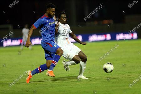 Stock Photo of Al-Shabab's player Abdulmalek Al-Khaibri (R) in action against Abha's Firas Chaouat (L) during the Saudi Professional League soccer match between Al-Shabab and Abha, in Riyadh, Saudi Arabia, 24 August 2020.