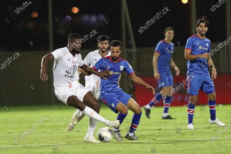 Al-Shabab's player Alfred N'Diaye (L) in action during the Saudi Professional League soccer match between Al-Shabab and Abha, in Riyadh, Saudi Arabia, 24 August 2020.