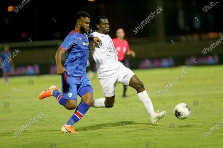 Al-Shabab's player Abdulmalek Al-Khaibri (R) in action against Abha's Firas Chaouat (L) during the Saudi Professional League soccer match between Al-Shabab and Abha, in Riyadh, Saudi Arabia, 24 August 2020.