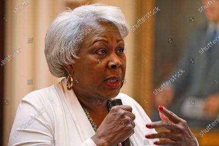 """File-Senate President Pro Tempore, Sen. Louise Lucas speaks during a debate on the Senate floor at the Capitol, in Richmond, Va. Lucas, 76, a Black woman and high-ranking Democratic power broker, stood near the 56-foot (17-meter) memorial in the city of Portsmouth. Police said she was with a group of people shaking up cans of spray paint. """"(T)hey gonna do it, and you can't stop them ... they got a right, go ahead!"""" police claim Lucas said. Lucas's alleged statements are in a probable cause summary police filed last week. Two felony charges say she and several others conspired to damage the 19th Century memorial during a protest"""
