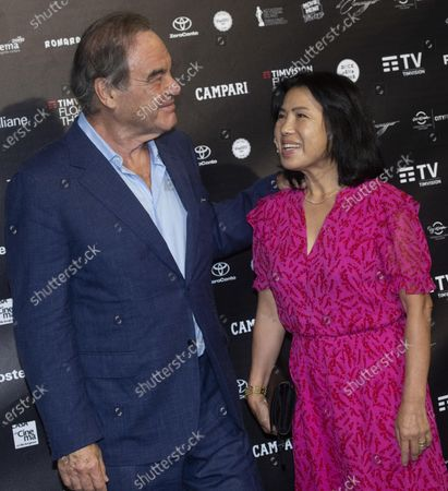 Oliver Stone with his wife Sun-jung Jung during the inauguration of TimVision Floating theatre in Rome, 24 August 2020. Stone is to inaugurate the Timvision Floating Theatre festival presenting international movies from 24 August to 24 September 2020 at the 'Parco Centrale del Lago' in Rome.