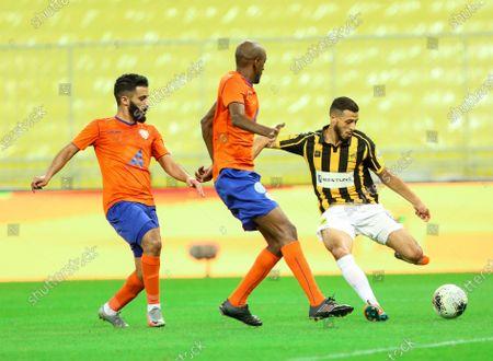 Stock Picture of Al-Ittihad's player Anice Badri (R) in action against Al-Feiha's Sami Al-Khaibary (C) during the Saudi Professional League soccer match between Al-Ittihad and Al-Feiha, 30 kilometers north of Jeddah, Saudi Arabia, 24 August 2020.