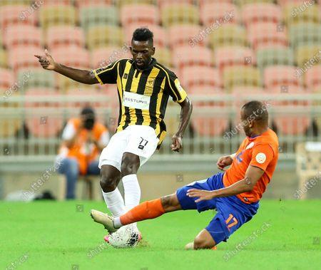 Al-Ittihad's player Abdulaziz Al-Bishi (L) in action against Al-Feiha's Hani Al-Subayani (R) during the Saudi Professional League soccer match between Al-Ittihad and Al-Feiha, 30 kilometers north of Jeddah, Saudi Arabia, 24 August 2020.