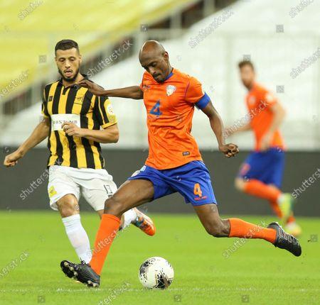Al-Ittihad's player Anice Badri (L) in action against Al-Feiha's Sami Al-Khaibary (R) during the Saudi Professional League soccer match between Al-Ittihad and Al-Feiha, 30 kilometers north of Jeddah, Saudi Arabia, 24 August 2020.