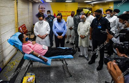 """BJP President J P Nadda and Union Health Minister Harsh Vardhan talk to a blood donater during a blood donation camp organised to mark the first death anniversary of former union minister Arun Jaitley, at AIIMS Hospital on August 24, 2020 in New Delhi, India. Remembering former Union Minister and senior BJP leader Arun Jaitley on his first death anniversary, Prime Minister Narendra Modi on Monday said, """"I miss my friend a lot."""" Arun Jaitley had died at Delhi's AIIMS last year."""