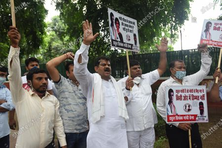 Stock Photo of Congress workers hold placards and raise slogans outside AICC headquarters demanding a member from Gandhi family be appointed as the party president on August 24, 2020 in New Delhi, India. After a letter complaining about the drift in the party and the leadership vacuum, the Gandhis gathered forces and got the Congress Working Committee (CWC) to pass a resolution endorsing Sonia Gandhi as the Interim President.