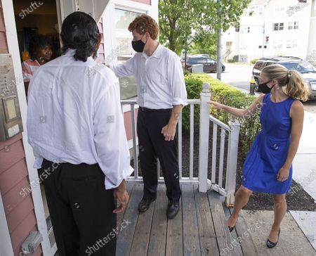 Congressman Joe Kennedy III (2R) his wife Lauren Anne Birchfield (R) and Texas Congressman Al Green (2L) speak with a voter (L) in the doorway of her home in Boston, Massachusetts, USA, 24 August 2020. Kennedy is challenging incumbent Senator Ed Markey in the Massachusetts Democratic primary that is to be held on 01 September 2020.