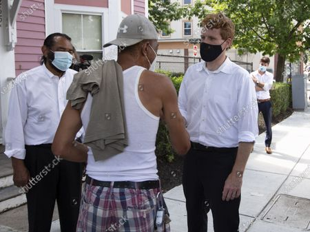 Congressman Joe Kennedy III (R) and Texas Congressman Al Green (L) talk with a voter while campaigning door to door in Boston, Massachusetts, USA, 24 August 2020. Kennedy is challenging incumbent Senator Ed Markey in the Massachusetts Democratic primary that is to be held on 01 September 2020.
