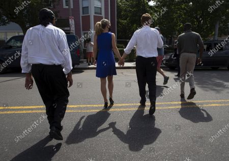 Congressman Joe Kennedy III (2R) holds the hand of his wife, Lauren Anne Birchfield (2L) as they cross a street with Texas Congressman Al Green (L), while campaigning door to door in Boston, Massachusetts, USA, 24 August 2020. Kennedy is challenging incumbent Senator Ed Markey in the Massachusetts Democratic primary that is to be held on 01 September 2020.