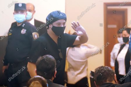 Former Brazilian soccer player Ronaldinho Gaucho waves after a hearing at the Justice Palace in Asuncion, Paraguay, 24 August 2020. A Paraguayan judge released with conditions to Ronaldinho and his brother Roberto de Assis Moreira, who were arrested on 04 March 2020 upon their arrival to Paraguay for a promotional and charity events with fake passaports.