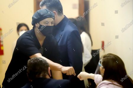 Stock Image of Former Brazilian soccer player Ronaldinho Gaucho (L) fist bumps with prosecutor Alicia Sapriza after a hearing at the Justice Palace in Asuncion, Paraguay, 24 August 2020. A Paraguayan judge released with conditions to Ronaldinho and his brother Roberto de Assis Moreira, who were arrested on 04 March 2020 upon their arrival to Paraguay for a promotional and charity events with fake passaports.
