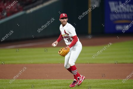 St. Louis Cardinals third baseman Brad Miller commits a throwing error allowing Kansas City Royals' Alex Gordon to reach base during the fifth inning of a baseball game, in St. Louis