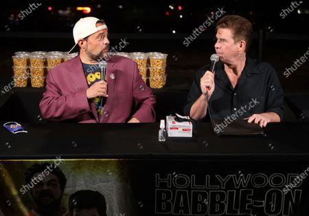 """Stock Photo of Kevin Smith, left, and Ralph Garman participate in the """"Hollywood Babble-On"""" podcast at the Vineland drive-in, in Industry, Calif"""