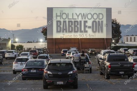 """Stock Picture of Couple sit in their truck as they wait for Kevin Smith and Ralph Garman to participate in the """"Hollywood Babble-On"""" podcast at the Vineland drive-in, in Industry, Calif"""