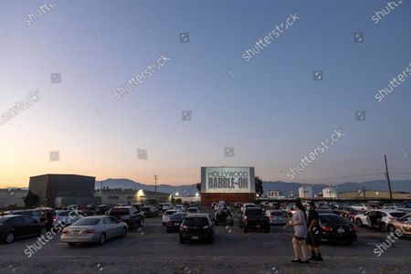 """Several people wait in their vehicles for Kevin Smith and Ralph Garman to participate in the """"Hollywood Babble-On"""" podcast at the Vineland drive-in, in Industry, Calif"""
