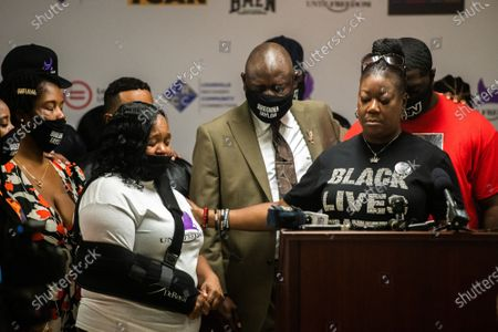 """Sybrina Fulton, the mother of Trayvon Martin shares a moment with Breonna Taylor's mother, Tamika Palmer at the Until Freedom press conference pushing for """"Breonna's Law for Kentucky,"""" a statewide ban on no-knock warrants during Day Three of BreonnaCon at Simmons College"""