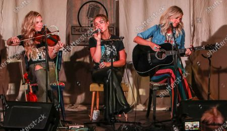 Stock Image of Natalie Stovall, Naomi Cooke and Jennifer Wayne of Runaway June perform onstage at The Listening Room Cafe on August 24, 2020 in Nashville, Tennessee.