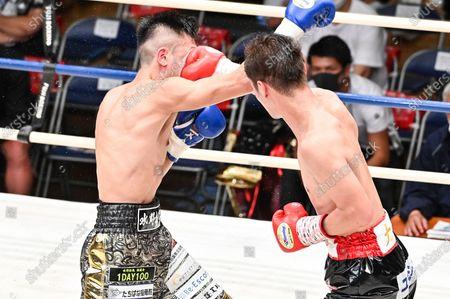 (R-L) Ryo Matsumoto, Takuya Mizuno - Boxing : 8R featherweight bout at Korakuen Hall in Tokyo, Japan.