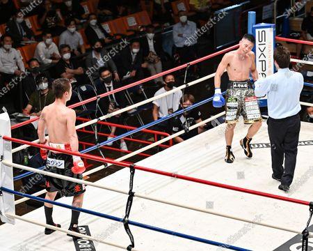 (L-R) Ryo Matsumoto, Takuya Mizuno - Boxing : 8R featherweight bout at Korakuen Hall in Tokyo, Japan.