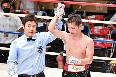 Stock Photo of Ryo Matsumoto - Boxing : 8R featherweight bout at Korakuen Hall in Tokyo, Japan.