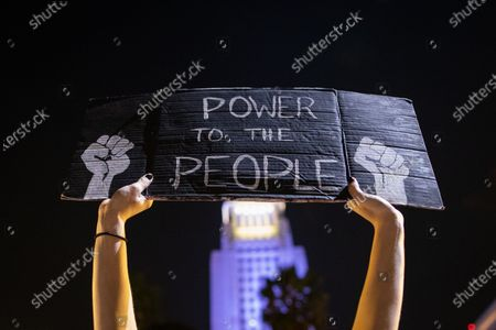 A Black Lives Matter protester holds a sign at a protest in Los Angeles, California, USA, 24 August 2020. The protest was organized in response to the police shooting of Jacob Blake in Wisconsin and Anthony McClain in Pasadena.