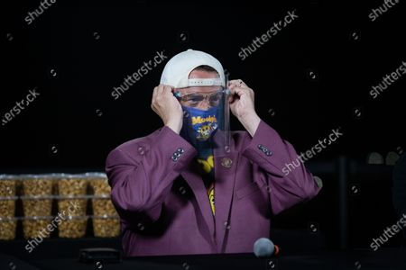 Kevin Smith puts on a face mask while attending a drive-in movie at the Hollywood Babble-On 10th Anniversary Drive-In Bash in City of Industry, California, USA, 24 August 2020.