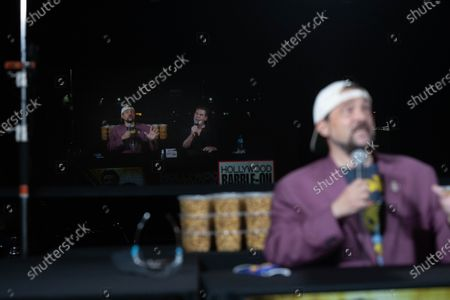 Kevin Smith (L as reflection and R) and US radio host Ralph Garman (C) attend a drive-in movie at the Hollywood Babble-On 10th Anniversary Drive-In Bash in City of Industry, California, USA, 24 August 2020.