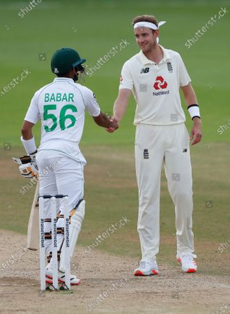 England's Stuart Broad, right, shakes hands with Pakistan's Babar Azam at the end of the fifth day of the third cricket Test match between England and Pakistan, at the Ageas Bowl in Southampton, England