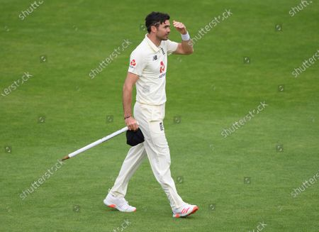 England's James Anderson walks off the field with a stump at the end of the fifth day of the third cricket Test match between England and Pakistan, at the Ageas Bowl in Southampton, England