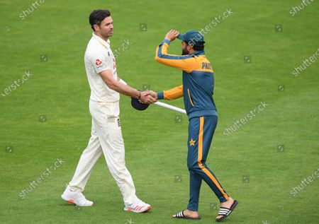 Pakistan's captain Azhar Ali, right, shakes hands with England's James Anderson at the end of the fifth day of the third cricket Test match between England and Pakistan, at the Ageas Bowl in Southampton, England