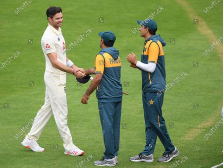 Pakistan players greet England's James Anderson, left, at the end of the fifth day of the third cricket Test match between England and Pakistan, at the Ageas Bowl in Southampton, England