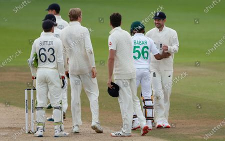 Pakistan's Babar Azam, second right, congratulates England's James Anderson, right, at the end of the fifth day of the third cricket Test match between England and Pakistan, at the Ageas Bowl in Southampton, England